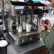 Barista making coffee at a typical local business