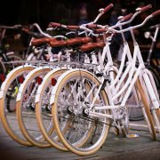 Four identical white bicycles showing no innovations since the 1970s