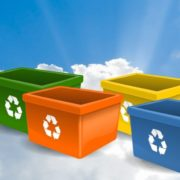 Colorful recycling bins floating in a promising sky